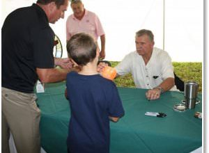 Photo of Mike Ditka Swoops Into EverGreen; Gayle Sayers Pays Surprise Visit